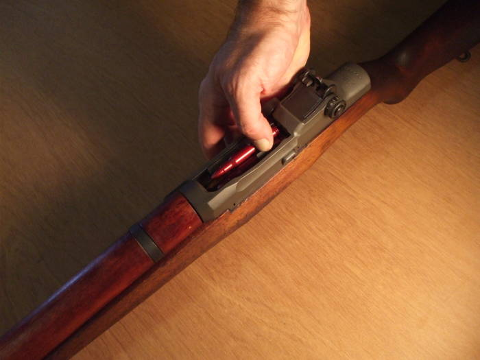 How to safely load an M1 Garand: block the operating rod handle with the heel of your left hand.
