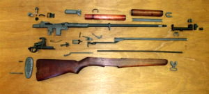 M1 Garand rifle collection of parts ready for assembly.