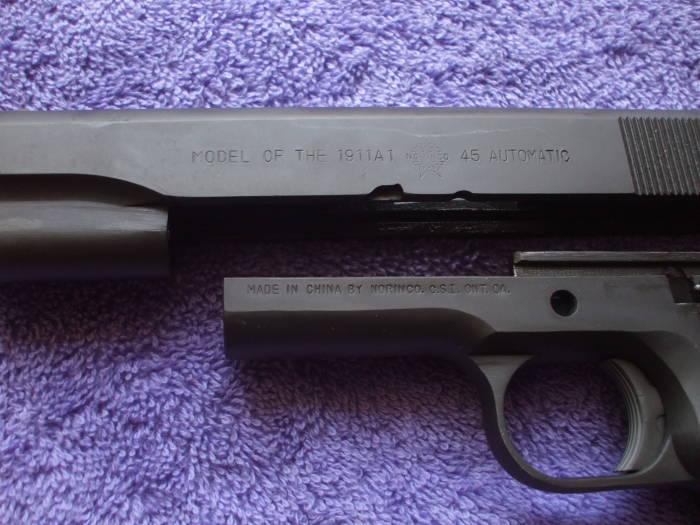 Frame And Slide Of A Parkerized M1911 Pistol