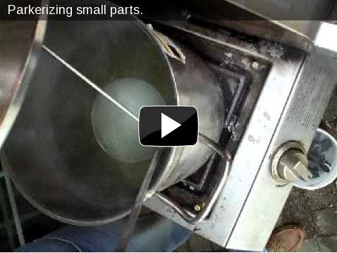 Video of parkerizing: small gun parts in a stainless steel ladle, the solution starts bubbling immediately.