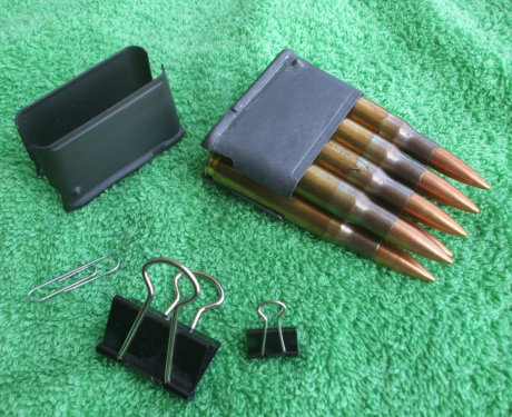 En-bloc clips for the M1 Garand rifle, a paper clip, and two binder clips.
